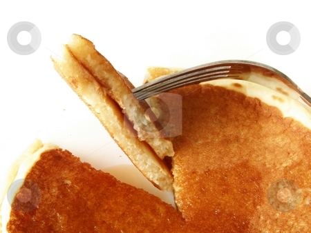 Pancakes 3 stock photo, Image of two sliced pancakes with maple syrup, with metal fork. by Jill Oliver