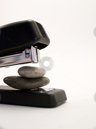 Super Stapler, Vertical 2 stock photo, Close up image of a black stapler about to staple together two stones.  Vertical orientation. by Jill Oliver