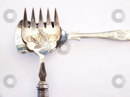 Antique Fork and Antique Sugar Spoon stock photo, Image of an antique pickle fork and antique sugar spoon laying together toward top left portion of the image.  Horizontal orientation. by Jill Oliver