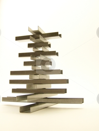 Staple Structure, Full stock photo, Full image of a structure made of replacement staples.  White background and vertical orientation. by Jill Oliver
