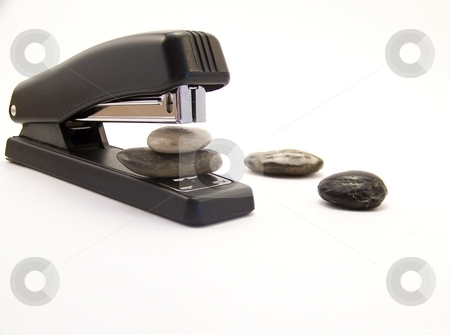 Super Stapler stock photo, Image of a black stapler, about to staple two rocks together, with other rocks nearby.  Horizontal orientation. by Jill Oliver