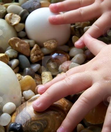 Child's Hands with Pebbles and Stone Eggs, Vertical stock photo,  by Jill Oliver