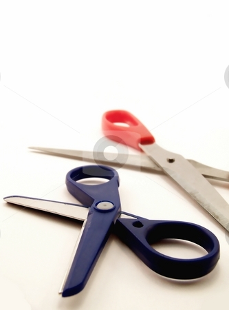 Two Pairs of Scissors, Vertical stock photo, Image of two pairs of scissors, one large and one small, one red and one blue, on a white background.  Vertical orientation. by Jill Oliver