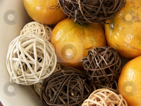 Honey Tangerines and Vine Decorations stock photo, Image of honey tangerines and vine decorations.  Horizontal orientation. by Jill Oliver