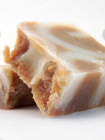 Crumbled Handmade Cinnamon Soap, Leaning stock photo, Image of a bar of handmade, handcut cinnamon soap broken into two pieces, one leaning against the other.  White background and vertical orientation. by Jill Oliver