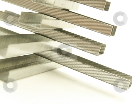 Staple Structure, Detail Horizontal stock photo, Image of a structure made of rows of metal replacement staples.  White background and Horizontal orientation. by Jill Oliver