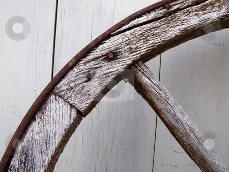 Wagon Wheel stock photo, Image of an old wooden wheel leaning on a wooden wall. by Jill Oliver