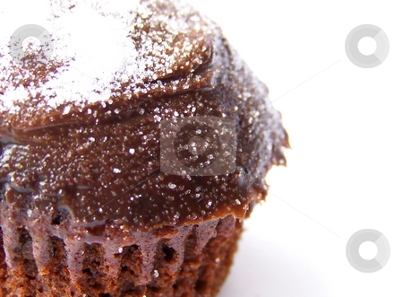 Chocolate Cupcake, Left stock photo, Detailed image of an iced chocolate cupcake with white granulated sugar on top, set to the left of the image.  Space remains to the right for text or other material.  White background, horizontal orientation. by Jill Oliver