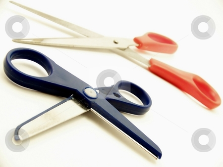 Two Pairs of Scissors, Horizontal stock photo, Image of two pairs of scissors, one large and one small, one red and one blue, on a white background.  Horizontal orientation. by Jill Oliver