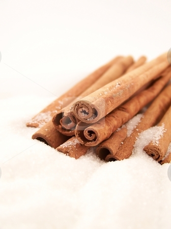 Cinnamon Sticks and Sugar stock photo, Vertical image of cinnamon sticks piled in white granulated sugar. by Jill Oliver