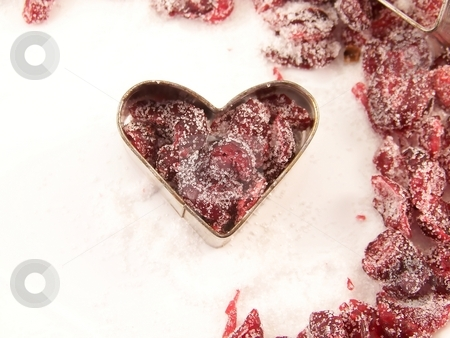 Dried Cranberries  and Sugar stock photo, Image of dried cranberries mixed with white granulated sugar, placed in a heart-shaped cookie cutter, with other cranberries surrounding. by Jill Oliver