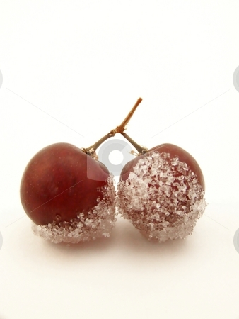 Sugared Grapes, Vertical stock photo, Image of two connected red grapes, dipped in white sugar.  White background and vertical orientation. by Jill Oliver