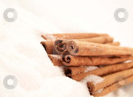 Cinnamon Sticks and Sugar stock photo, Horizontal image of cinnamon sticks piled in granulated white sugar, viewed at an angle. by Jill Oliver