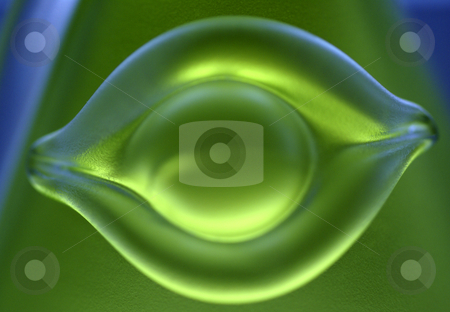 Green Eye stock photo, A macro shot of the side of a green perfume bottle, sculpted to form a face. by Tim Green