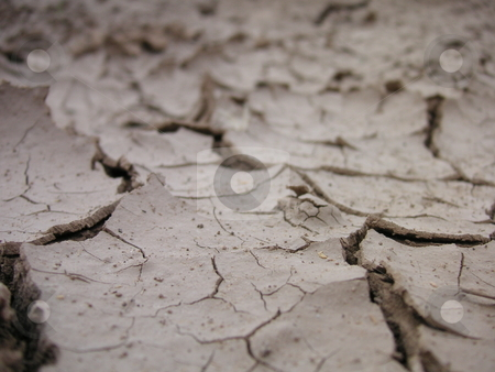 Parched Land stock photo, A ground level shot of dirt, parched by the blistering sun in the desert. by Caley Gonyea