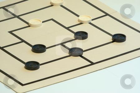 M?hlespiel, Zwickm?hle stock photo, M?hle ist ein einfaches Brettspiel f?r zwei Spieler. Das Grundprinzip ist es, drei Spielsteine in eine Reihe zu bekommen. M?hle wird auf einem Spielbrett gespielt, mit drei ineinander liegenden Quadraten mit Verbindungslinien in den Seitenmitten. by Wolfgang Heidasch