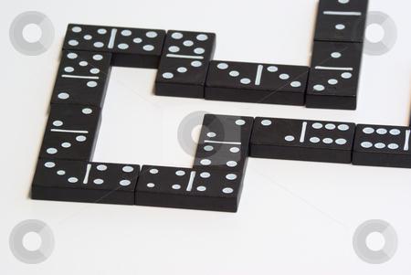 Domino stock photo, Domino ist ein Legespiel mit rechteckigen Spielsteinen, meist aus Holz oder Kunststoff. by Wolfgang Heidasch