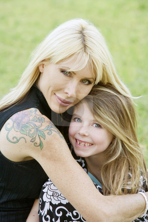 Mother and Daughter stock photo, Pretty mom hugs her cute freckle-faced daughter by Scott Griessel