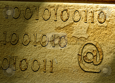 Ancient communications stock photo, Illustration of e-mail symbol and numbers carved on stone. by Ronald Hudson