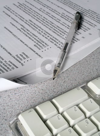 Office report stock photo, A pen rests on a typewritten document on desktop with computer keyboard in foreground. by Ronald Hudson