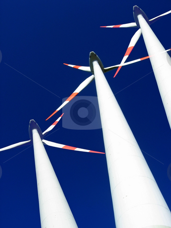 Wind power stock photo, Composite image of wind generators against blue sky. by Ronald Hudson