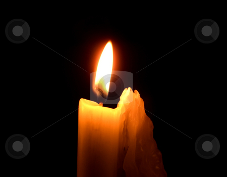 Burning candle stock photo, Single candle burning inside of church by Ronald Hudson