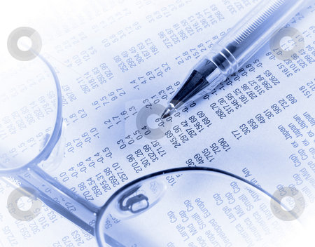Stocks and shares stock photo, Reading glasses and pen on shares section of newspaper by Ronald Hudson