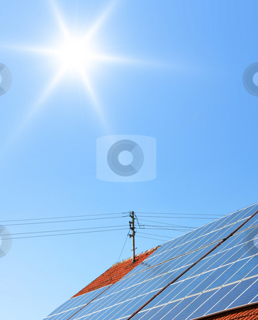 Solar panels stock photo, A Photograph of a solar panel on the roof by Markus Gann