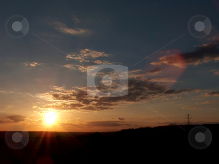 Sunset stock photo, A photography of a sunset over the german black forest by Markus Gann