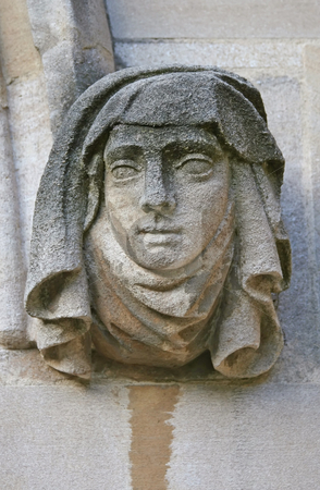 Stone face stock photo, A Photograph of an old stone figure by Markus Gann