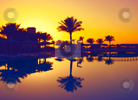 Pool sunset stock photo, A photography of a pool view with sunset by Markus Gann