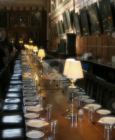 Table set for dinner party stock photo, Immense dinner table set up for a large dinner party in an old room by Markus Gann
