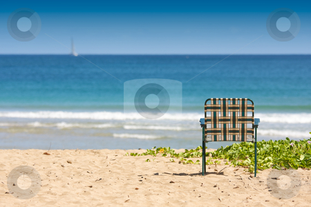 Inviting Shore Abstract stock photo, Chair sits on an inviting tropical shore. by Andy Dean