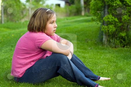 Pondering Life stock photo, Girl sitting on some green grass outside pondering life by Richard Nelson