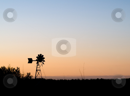 Weather Vane Silhouette stock photo, A weather vane silhouette against a sunset by Richard Nelson
