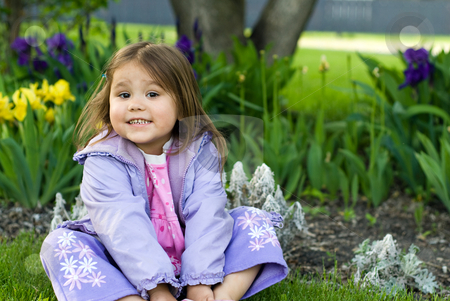 Flower Garden Girl stock photo, Little girl sitting in front of a flower bed by Richard Nelson