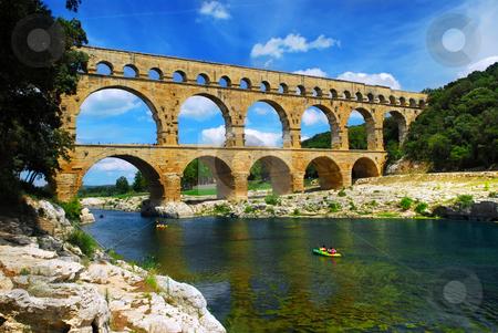 Pont du Gard in southern France stock photo, Pont du Gard is a part of Roman aqueduct in southern France near Nimes. by Elena Elisseeva