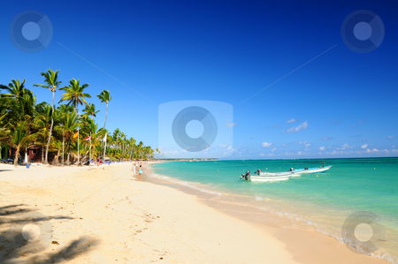 Sandy beach on Caribbean resort  stock photo, Sandy beach on Caribbean resort and fishing boats at sea by Elena Elisseeva