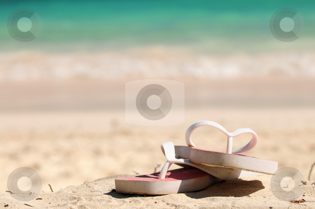 Flipflops on a sandy beach stock photo, Flipflops on a sandy ocean beach - vacation concept by Elena Elisseeva