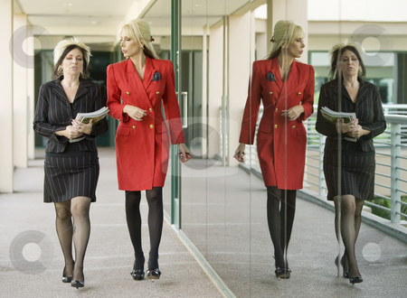 Modern Businesswomen on an Outdoor Walkway stock photo, Two Modern Businesswomen on an Outdoor Walkway with their Reflection by Scott Griessel