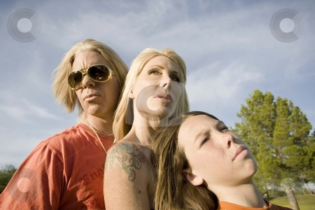 Rock and Roll Family stock photo, Portrait of a three-member casual family by Scott Griessel