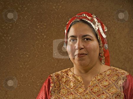 Muslim Woman stock photo, Muslim Woman in a Red Scarf in front of a Gold Wall by Scott Griessel
