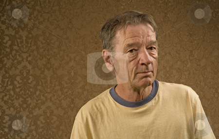 Man in a Yellow Shirt stock photo, Man with a craggy face wearing a yellow shirt against a gold background with copy space by Scott Griessel