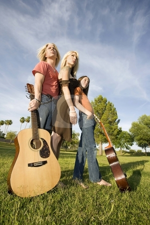 Rock and Roll Family stock photo, Three family members with two guitars by Scott Griessel