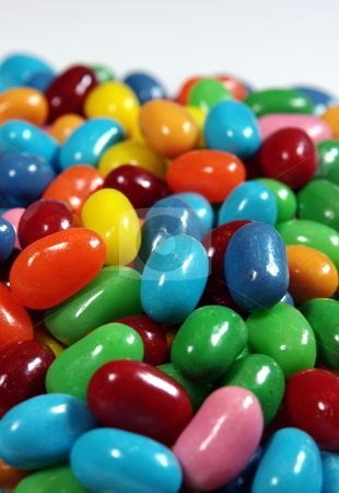 Jelly Beans stock photo, Multiple colored jelly beans on a light background. by Lynn Bendickson