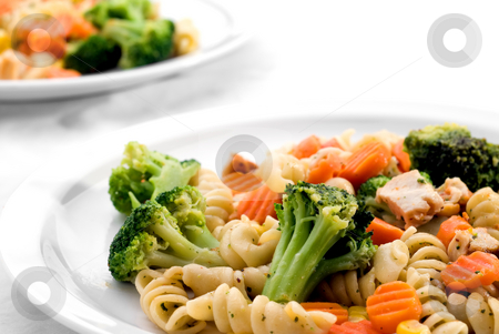 Pasta and mixed vegetables stock photo, Two dishes of pasta with mixed vegatables by Vince Clements