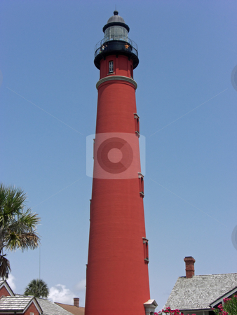 Ponce Inlet Lighthouse stock photo, This is the tallest lighthouse in Florida. Located approximately 10 miles south of Daytona Beach, it is visited by over 120,000 people each year and was designated a National Historic Landmark in 1998, making it one of only 10 lighthouses with this designation. by Rebecca Mosoetsa