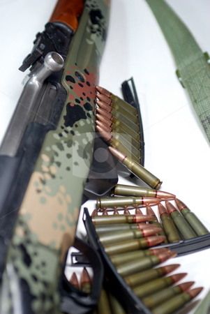 Military Rifle And Ammunition stock photo, An old military rifle with stripper clips of ammunition by Lynn Bendickson