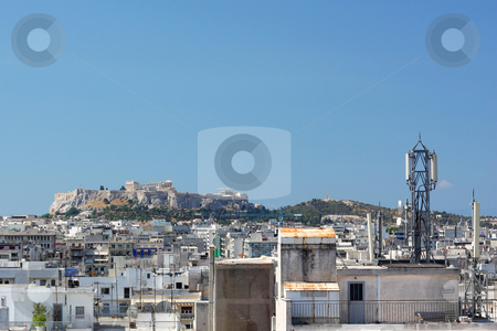 Acropolis Urban View stock photo, A distant view of the Acropolis of Athens over the non-touristic part of downtown by Georgios Alexandris