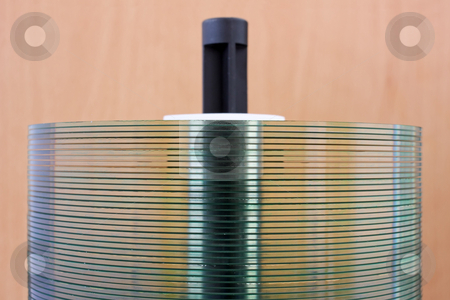 CD Stack stock photo, A side close up of a stack of CDs by Georgios Alexandris